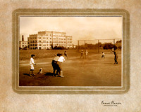 Boys playing baseball with old Sacred Heart Hospital in background